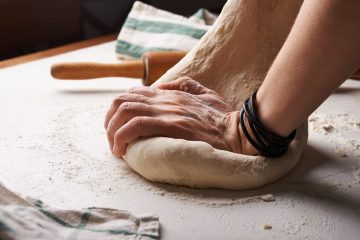 Image of hands kneading dough