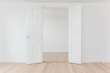 Image of empty room with open door and white walls